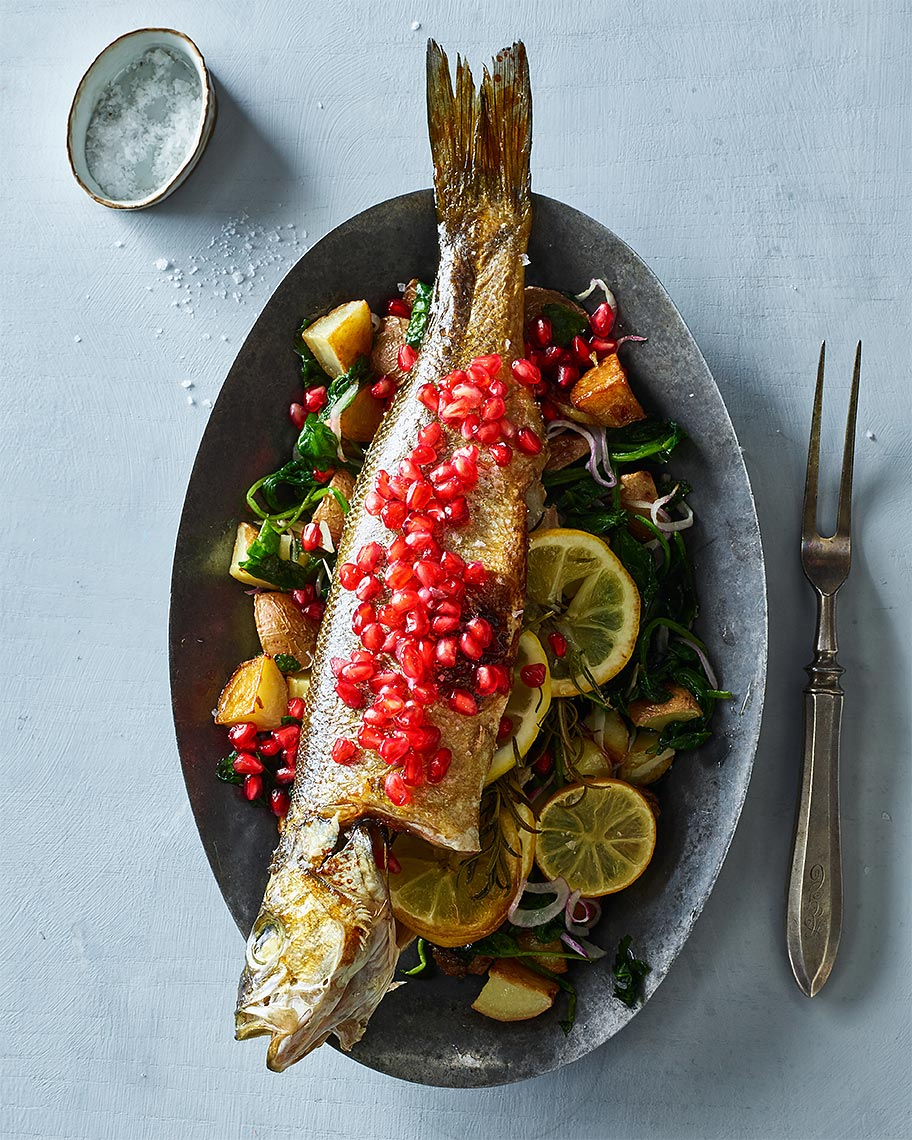 ww18_eric-greenspan_ch6_pomegranate-glazed-whole-branzino-with-wilted-spinach-and-red-bliss-potatoes_1396